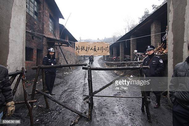 Relatives of victims gather at the entrance of Lisheng Coal Mine where cought a fire in Xiangfan Hunan province January 6 2010 Twentyseven miners...