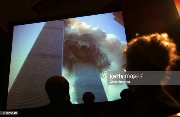 Relatives of victims in the September 11, 2001 terror attacks watch video footage of the attack during the September 11 commission hearings May 18,...