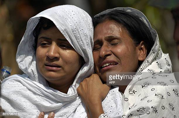 Relatives of victims killed during a mutiny by the Bangladesh Rifles break down in tears as they attend a funeral in Dhaka on March 2 2009 Bangladesh...