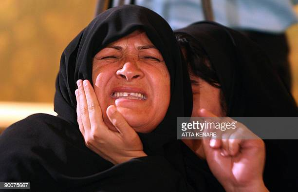 Relatives of victims killed in attacks allegedly launched by the Jundallah Sunni rebel group mourn during a press conference for top rebel Abdolhamid...