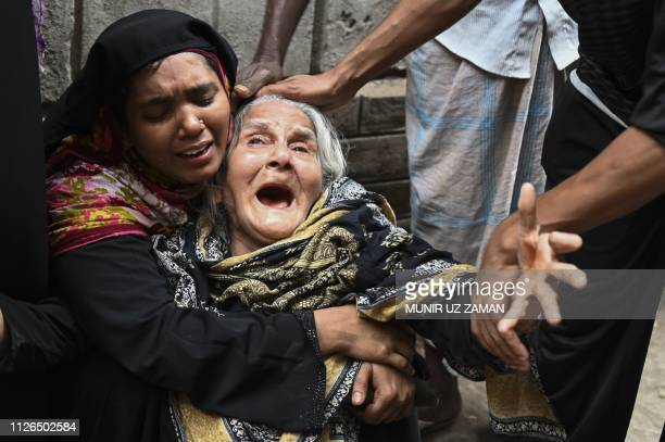 Relatives of victims mourn after a fire tore through apartment blocks in Bangladesh's capital Dhaka on February 21 2019 At least 70 people were...