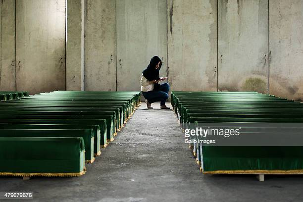 Relatives of victims mourn their loss on July 10 2014 at the Srebrenica Potocari Memorial and Cemetery at Potocari Bosnia During the 19921995 Bosnian...