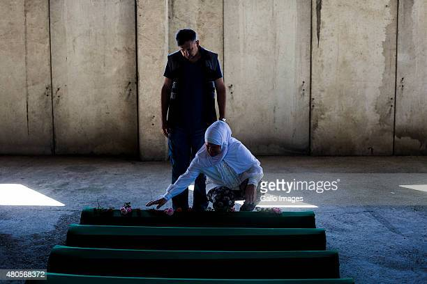 Relatives of victims mourn their loss on July 10 2015 at the Srebrenica Potocari Memorial and Cemetery at Potocari Bosnia During the 19921995 Bosnian...