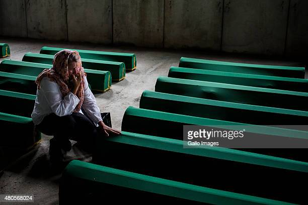 Relatives of victims mourn their loss on July 9 2015 at the Srebrenica Potocari Memorial and Cemetery at Potocari Bosnia During the 19921995 Bosnian...
