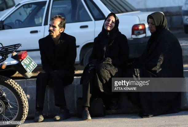 Relatives of victims of a stampede that broke out at the funeral of Revolutionary Guards commander Qasem Soleimani wait outside Bahonar hospital in...