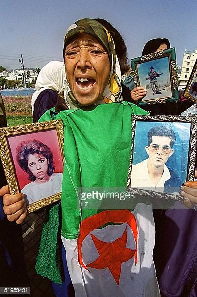 Relatives of victims of acts of terrorism protest during a rally organised by the coordination committee for truth and justice on Place de la...