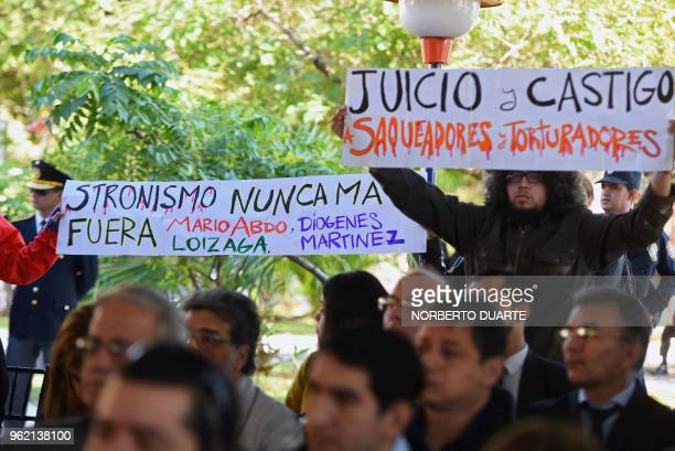 Relatives of victims of Alfredo Stroessner's dictatorship attend a ceremony in which the Paraguayan state offered an historic public apology for the...