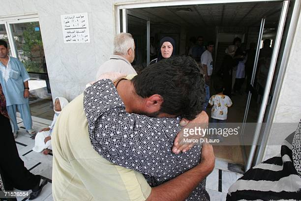 Relatives of victims of an Israeli air strike embrace outside a hospital on July 27, 2006 in Tyre, Lebanon. Israel's government voted today against...