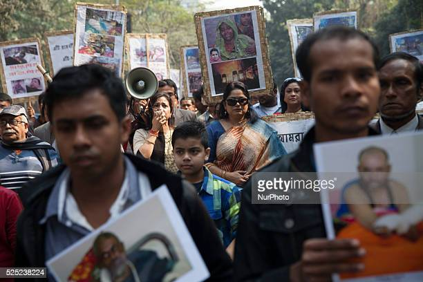 Relatives of victims of arson attack stage a protest at Central Shahid Minar in Dhaka against the blockade imposed by the BNP lead 20 party...