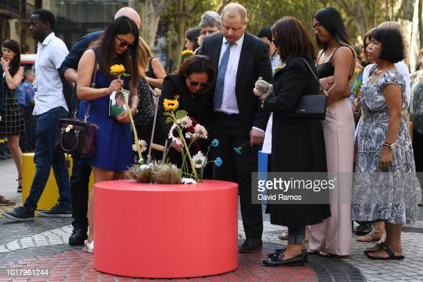 Relatives of victims of Barcelona and Cambrils terror attacks lay a floral tribute at Las Ramblas on August 17 2018 in Barcelona Spain The Barcelona...