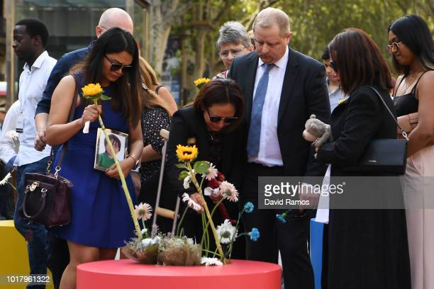 A couple lay a flower to pay tribute to the victims of last year's terror attack at the Las Ramblas in Barcelona on August 17 2018 in Barcelona...