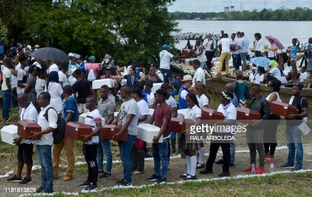 Relatives of victims of Bojaya massacre the single most deadly attack on civilians in Colombia's armed conflict carry some 101 urns with the remains...