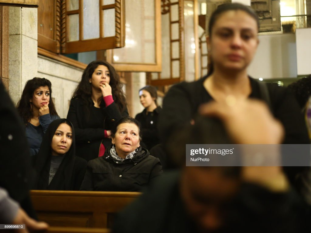 Relatives of victims of Egypt's Mar Mina church attack, mourn during their funeral service, at a church in Helwan, South-eastern Cairo, Egypt, 29 December 2017. At least ten people were killed Friday when a terrorist attack on the Marminna church was foiled in Helwan, south of Cairo.
