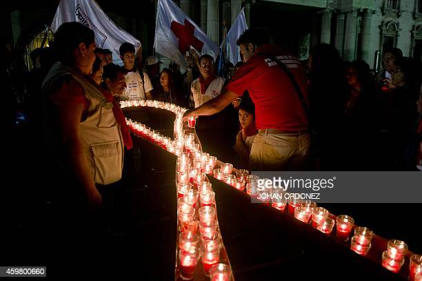 Relatives of victims of HIV/AIDS attend a vigil on December 1 2014 in Guatemala City to mark World AIDS Day AFP PHOTO/Johan ORDONEZ