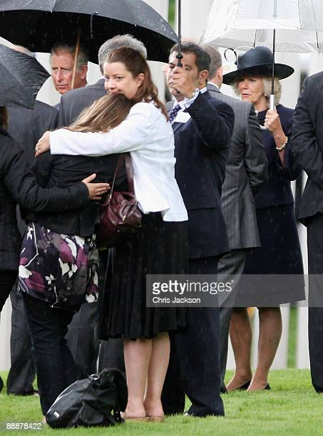 Relatives of victims of the July 7 Bombings comfort each other as they are met by Prince Charles Prince of Wales and Camilla Duchess of Cornwall at...