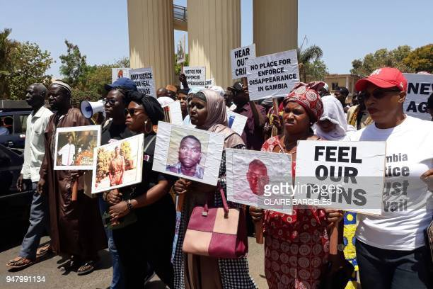 Relatives of victims of the regime of former Gambia President Yahya Jammeh demonstrate in Banjul on April 17, 2018 demanding answers on the state of...