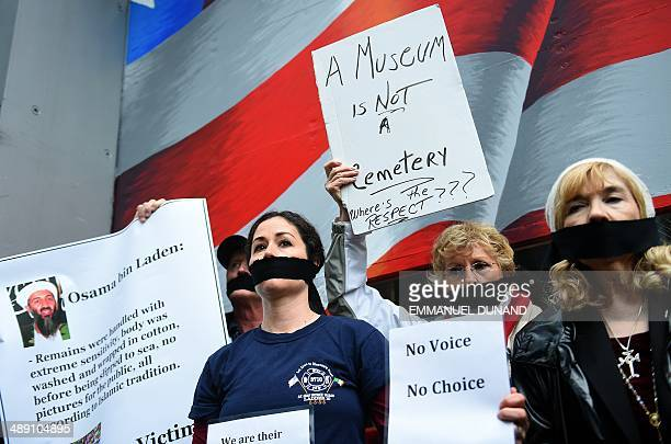 Relatives of victims of the September 11 2001 attacks stage a protest as unidentified remains of some of the victims in the attacks are escorted to a...