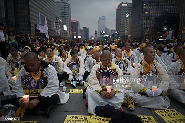 Relatives of victims of the Sewol ferry disaster hold a candlelight vigil in central Seoul on April 5 2015 More than 600 people including relatives...