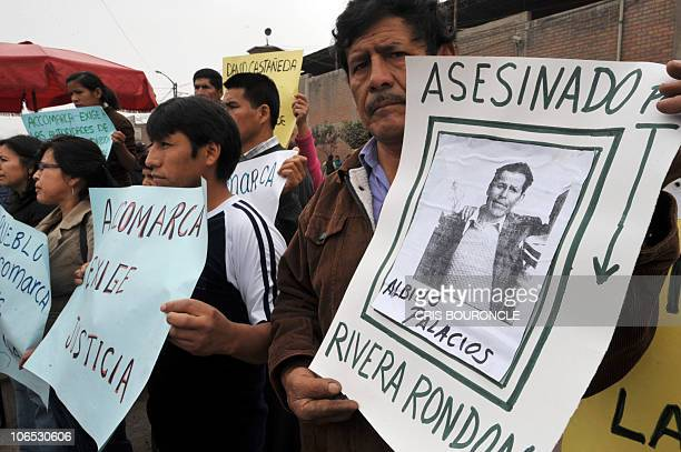 Relatives of victims of the slaughter of 69 peasants by members of the Peruvian Army in the village of Accomarca, protest outside a court dependency...