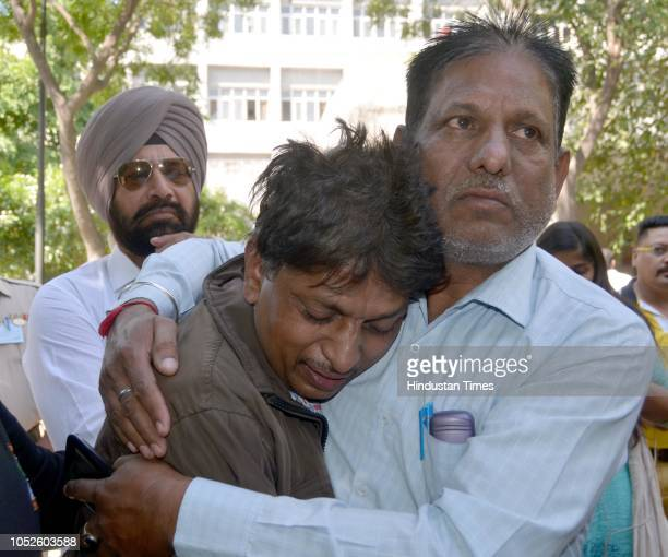 Relatives of victims of train accident mourn at Civil Hospital on October 20 2018 in Amritsar India A train plowed into a crowd that had spilled over...