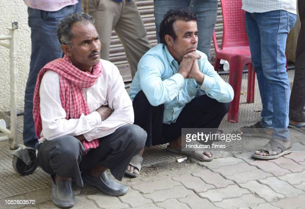 Relatives of victims of train accident wait outside the postmortem at Civil Hospital on October 20 2018 in Amritsar India A train plowed into a crowd...