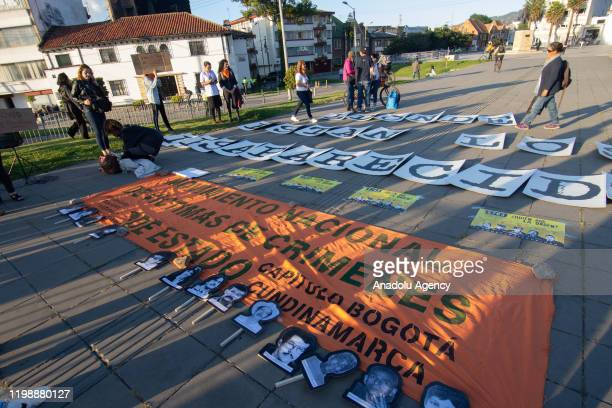 Relatives of victims of violence in Colombia protest against the new director of the National Center for Historical Memory Dario Acevedo in Bogotá...