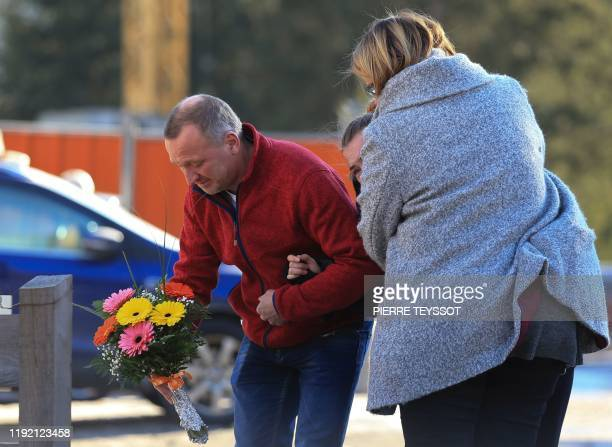 Relatives of victims put flowers at a makeshift memorial on Via Aurina in Lutago South Tyrol on January 6 2020 at the location where a drunk driver...