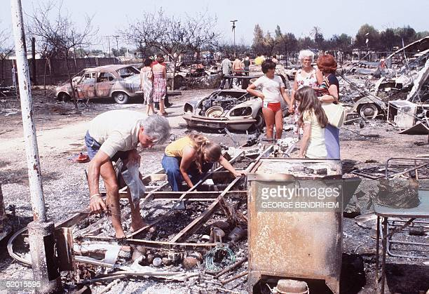 Relatives of victims search for personal belongings 12 July 1978 at Los Alfaques campsite devastated at 03 pm 11 July 1978 by a propane gas explosion...