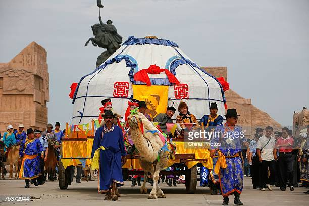 Relatives of world's tallest man Bao Xishun attend Bao's traditional Mongolian wedding ceremony at Genghis Khan's Mausoleum on July 12 2007 in the...