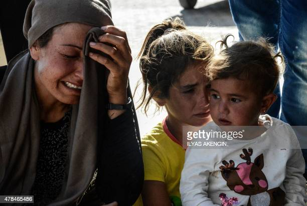 Relatives of wounded people react in front of the hospital of Suruc, Sanliurfa province, on June 25, 2015 after a deadly suicide bombing occurred in...