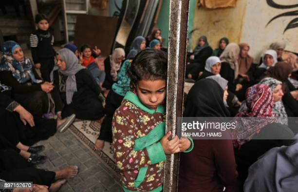 TOPSHOT Relatives of Zakaria alKafarneh who was killed during clashes with Israeli troops mourn during his funeral in Beit Hanoun in the northern...
