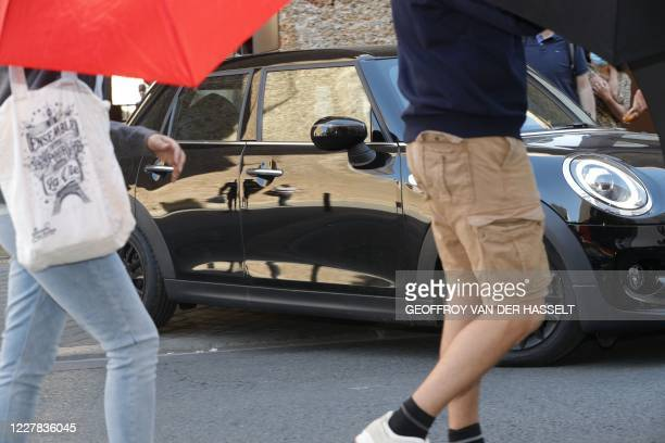 Relatives open umbrellas to hide former head of ETA Jose Antonio Urrutikoetxea also known as Josu Ternera leaving in a car upon his conditional...