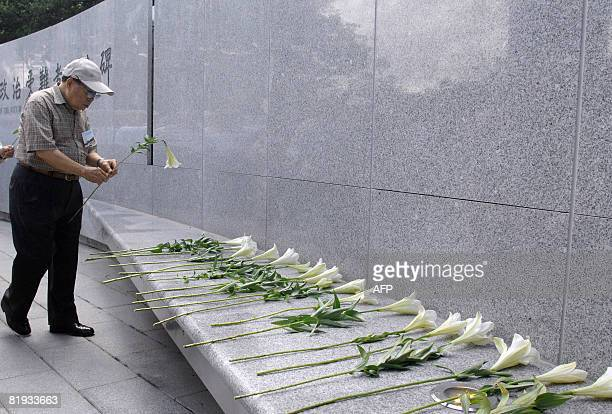 Relatives pay respect to the thousands of people killed while the island was placed under the Kuomintang's rule of martial law during a ceremony in...