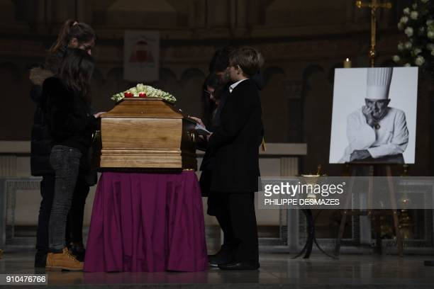 Relatives pay their respect by the coffin of French chef Paul Bocuse during the funeral ceremony t the SaintJean Cathedral in Lyon on January 26 2018...