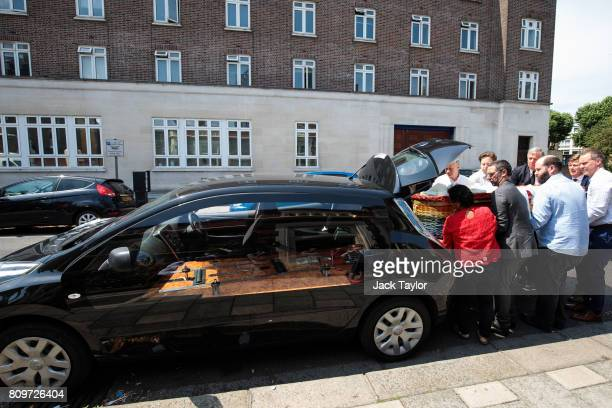 Relatives place the willow eco coffin of Jon Underwood into an electric hearse following the funeral at the Jamyang Buddhist Centre on July 6 2017 in...