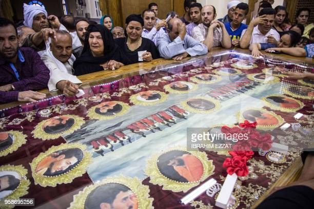 Relatives pray and mourn over the repatriated remains of 20 Egyptian Coptic Orthodox Christian men who were beheaded by jihadists loyal to the...