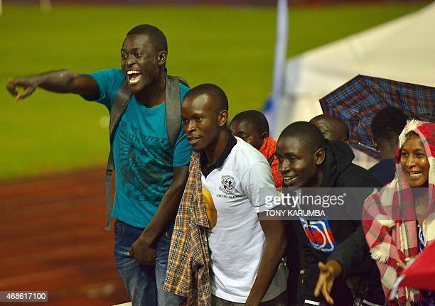 Relatives react after seeing their kins arriving at the Nyayo stadium in Nairobi on April 4 among survivors of an attack by islamist gunmen claimed...