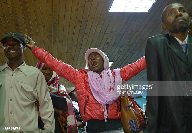 Relatives react as they wait for survivors in Nairobi on April 4 after an attack by islamist gunmen claimed by alShabab on a university campus in...