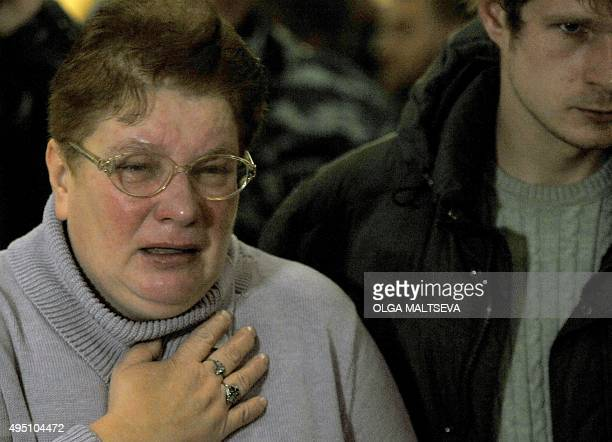 Relatives react at Pulkovo international airport outside St Petersburg after an Airbus A321 of Russian airline Kogalymavia with 224 people on board...