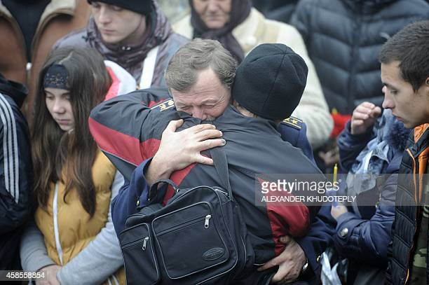 Relatives react during a burial service for Andrey Yeliseyev and Daniil Kuznetsov on November 7 2014 in the eastern Ukrainian city of Donetsk On...