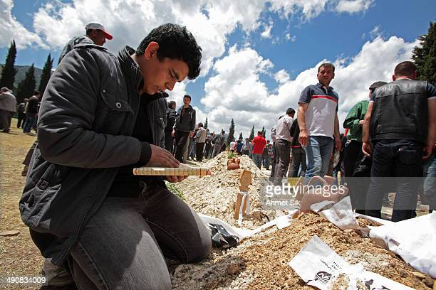 Relatives read the holy Kur'an during a funeral for the victims of a mining disaster on May 15, 2014 in Soma, a district in Turkey's western province...