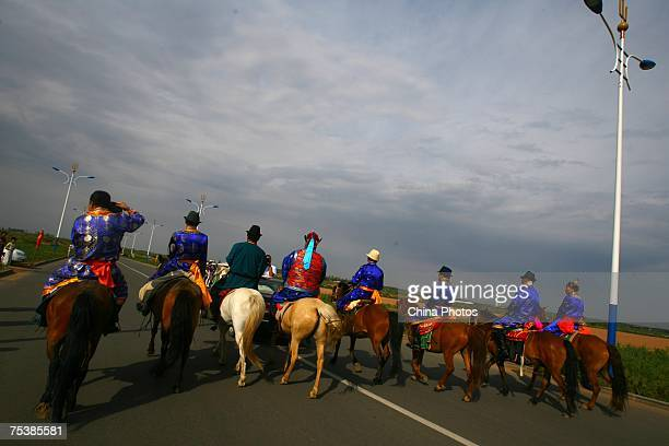 Relatives ride to meet world's tallest man Bao Xishun's bride Xia Shujuan during their traditional Mongolian wedding ceremony at Genghis Khan's...