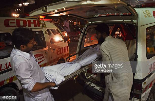 Relatives shift the dead body of a heatwave victim into an ambulance at the EDHI morgue in Karachi on June 21 2015 A heatwave has killed at least 45...