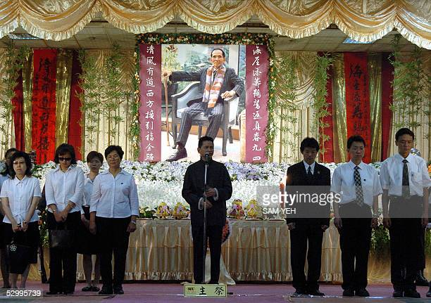 Relatives stand in front of a portrait of Taiwanese gang boss Hsu Hai Ching during his funeral in Taipei 29 May 2005 Thousands of gang members...