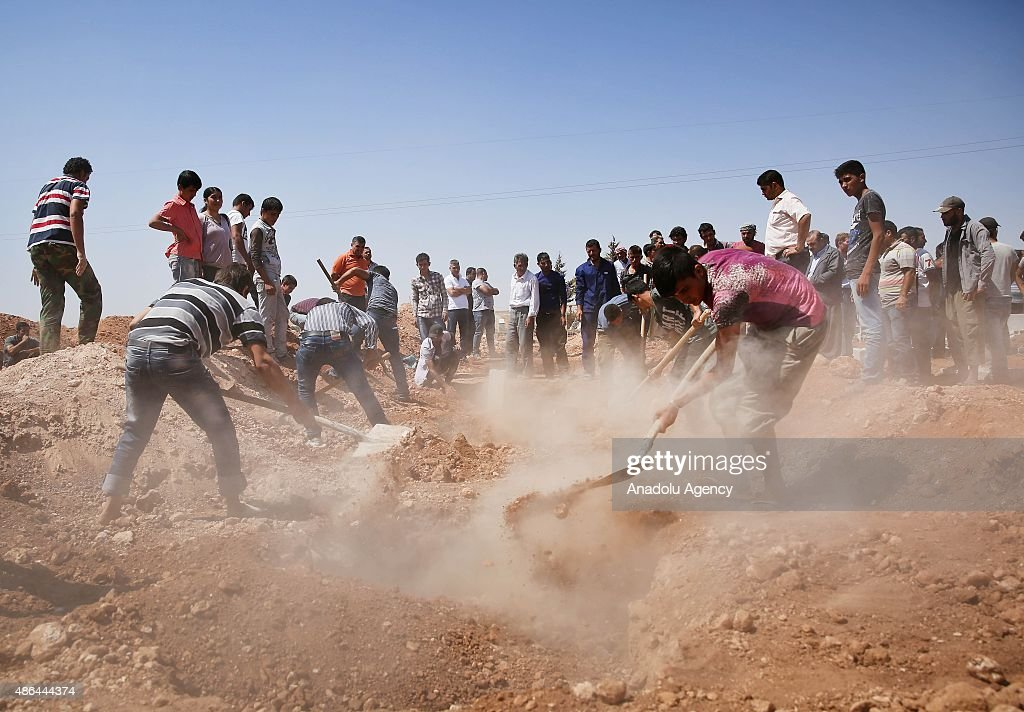 Funeral of drowned Syrian children and their mother in Kobani : News Photo