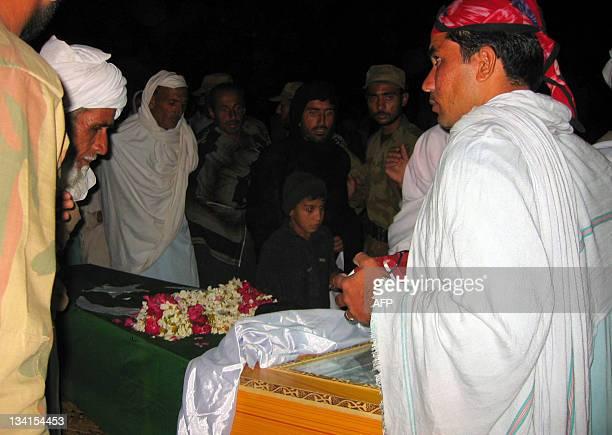 Relatives Take A Last Glimpse Of Pakis