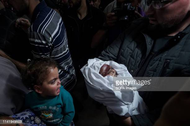 Relatives to the deceased seen carrying the body during the funeral of Maria alGazali a fourmonthold Palestinian baby who was martyred in an Israeli...
