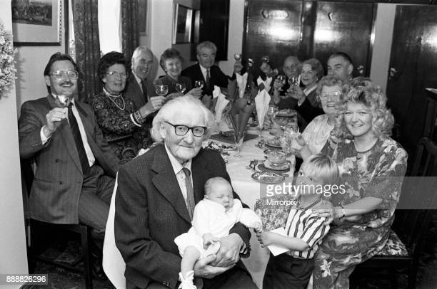 Relatives toast Mr Frederick Braund of Fixby at his 100th birthday celebration His is pictured with great grandsons Michael Watson three and sixweek...
