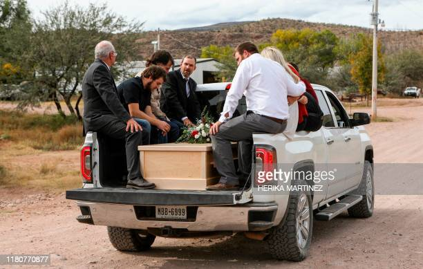 Relatives transport the coffins with the remains of Dawna Ray Langford and her sons Trevor and Rogan who were among nine victims killed on Monday in...