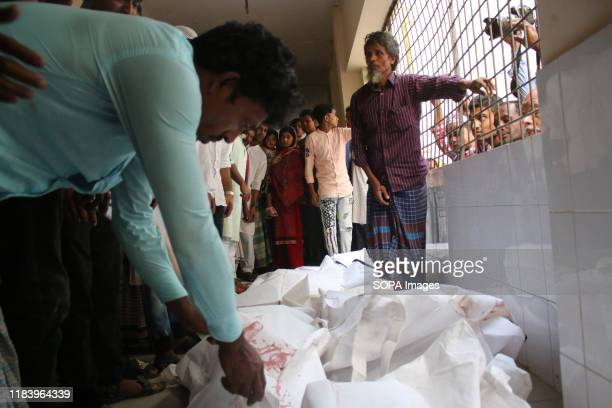 Relatives try to identify the bodies of the victims who died in a car accident at a local Hospital in Munshiganj At least ten people including two...